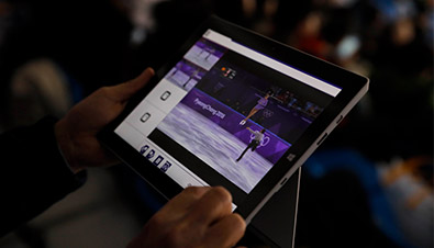 Photo: Operating a special application of a the multi-video streaming system by using a tablet