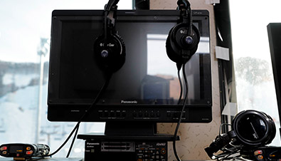 Photo of monitor and headphones used for optimum audio tuning work with simulation software at the installation site