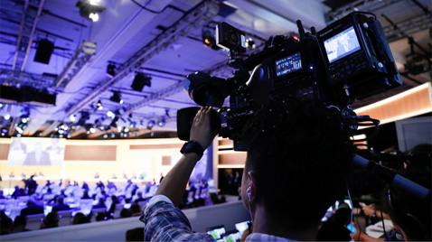 Photo: Cameraperson using an HD camera recorder at the International Broadcast Center (IBC) for the Olympic Games Rio 2016