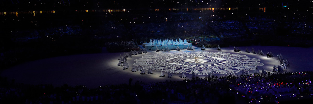 Photo: Panoramic view of geometric patterns being projected on the stadium's ground using DLP projectors at the closing ceremony of the Olympic Games Rio 2016