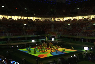 Photo: Opening act by gymnasts under the lights of DLP projectors at the gymnastics venue of the Olympic Games Rio 2016