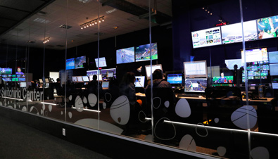 Photo: Staff working with multiple monitors at the International Broadcast Center (IBC) for the Olympic Games Rio 2016