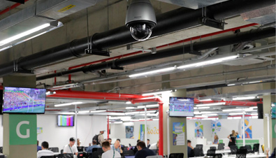 Photo: Outdoor security camera with housing installed on the ceiling of a facility