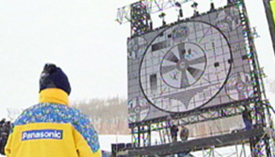 Photo: Staff checking an ASTROVISION large display unit installed in an extremely low temperature environment at a venue of the Olympic Winter Games Salt Lake 2002