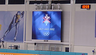 Photo: The Olympic rings and Olympic Winter Games Salt Lake 2002 emblem being shown on an ASTROVISION large display unit installed at a venue of the Olympic Winter Games Salt Lake 2002