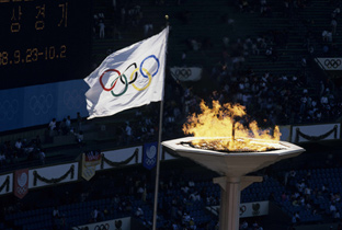 Photo: The Olympic flag being raised and Olympic cauldron being lit at a venue of the Olympic Games Seoul 1988