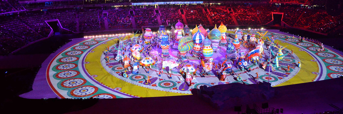 Photo: Panoramic view of colorful buildings used as part of the performance on the stadium's ground at the opening ceremony of the Olympic Winter Games Sochi 2014