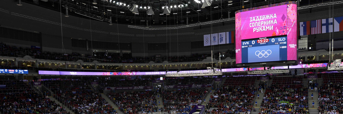 Photo: Score board and the Olympic rings shown on a large suspended screen and ribbon-shaped screens installed at a venue of the Olympic Winter Games Sochi 2014