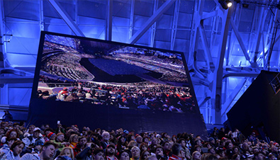 Photo: Spectators being shown on a large display unit installed at a venue of the Olympic Winter Games Sochi 2014