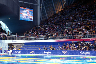 Photo: Competition being shown on an ASTROVISION large display unit installed at the swimming venue of the Olympic Games Sydney 2000