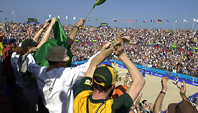 Photo: Spectators watching a competition at the beach volleyball venue of the Olympic Games Sydney 2000