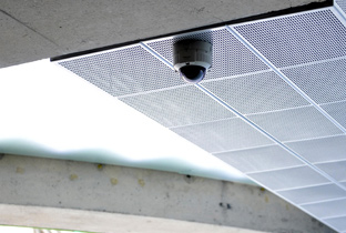 Photo: Dome-type security camera installed on the ceiling of a facility