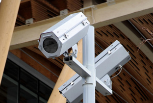 Photo: Box-type security cameras enclosed in a housing installed in the stands of a venue of the Olympic Winter Games Vancouver 2010