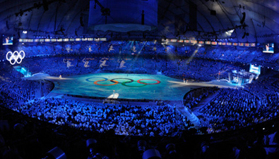 Photo: Panoramic view of the Olympic rings being shown on the ground of the BC Place main stadium at the opening ceremony of the Olympic Winter Games Vancouver 2010