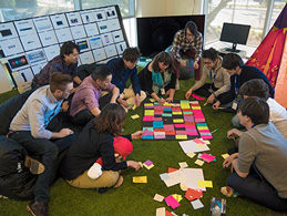 Photo: 11 members of Panasonic βin a design thinking activity using colorful cards.